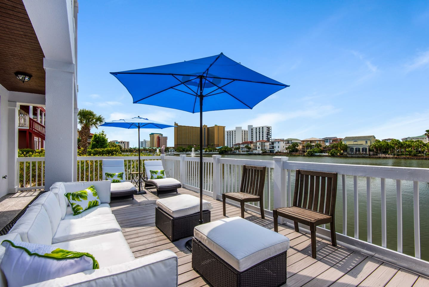 Expansive outdoor seating, dining and lounging overlooking a private dune lake.  Enjoy feeding our very entertaining turtles, ducks,  pelicans, and herons from the comfort of your home.