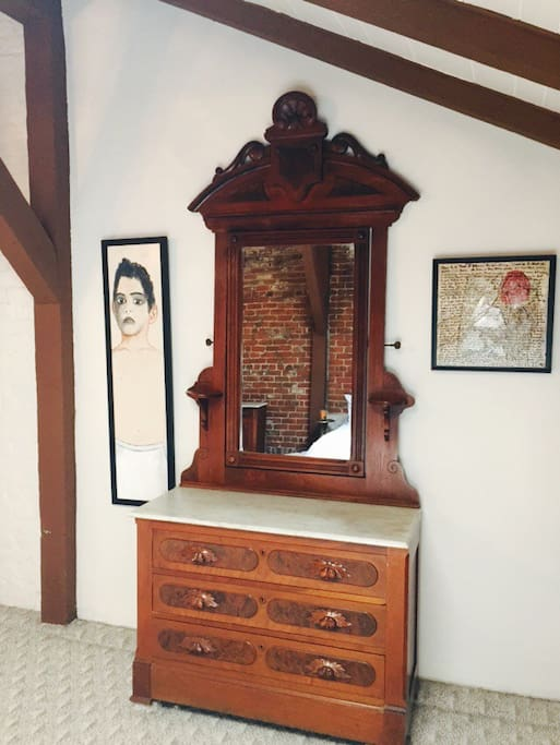 Antique Chest of drawers and original paintings in Master Suite.