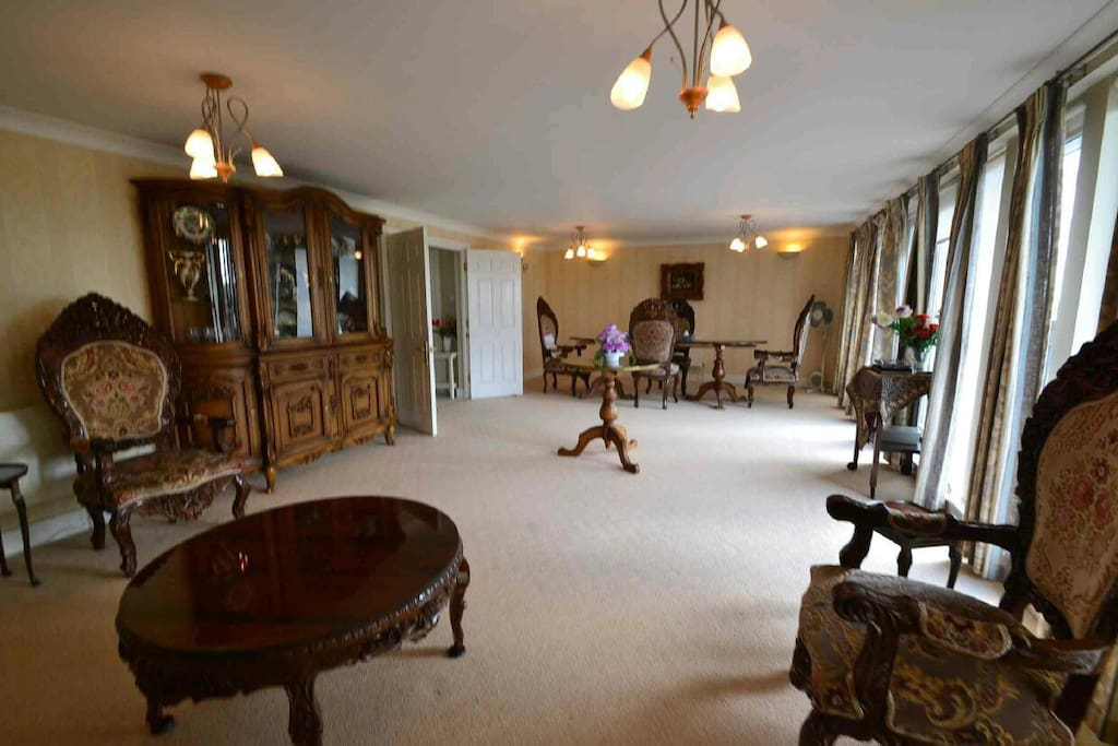 spacious reception and dining room with panoramic views of London.