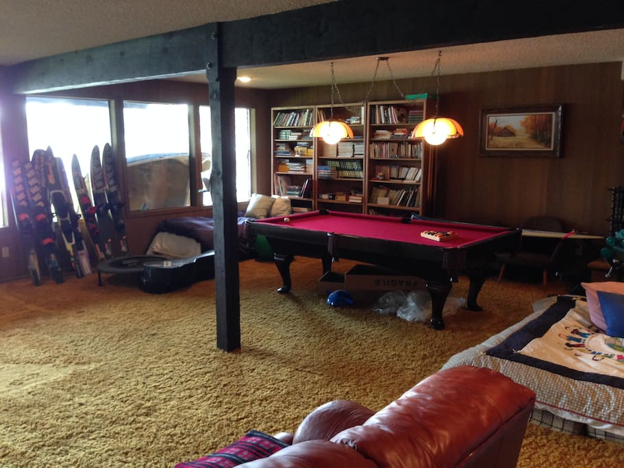 The basement will be all yours- pool table, ping pong, leather couch, bar/kitchen area. No tv.