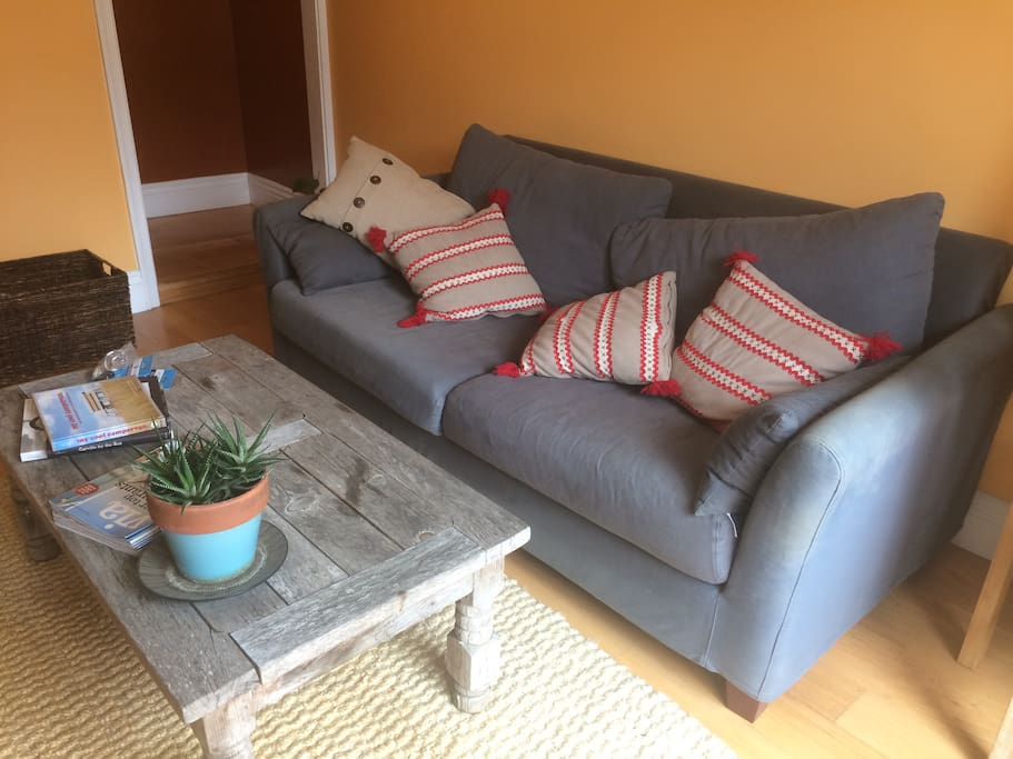 double seater sofa and beach wood coffee table