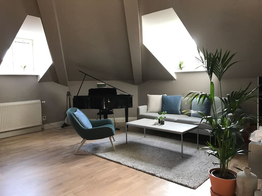 Our living room, with a grand piano in the corner.
