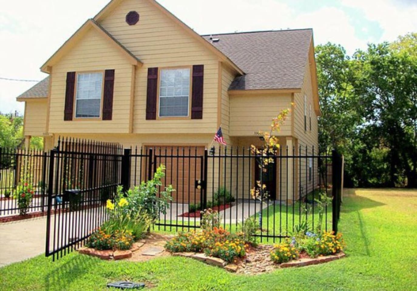 Outside of the home. Has attached garage and parking space inside automatic gate.