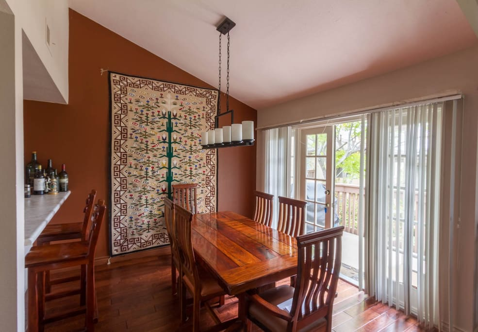 Beautiful dining room table and a balcony to enjoy the warm weather.