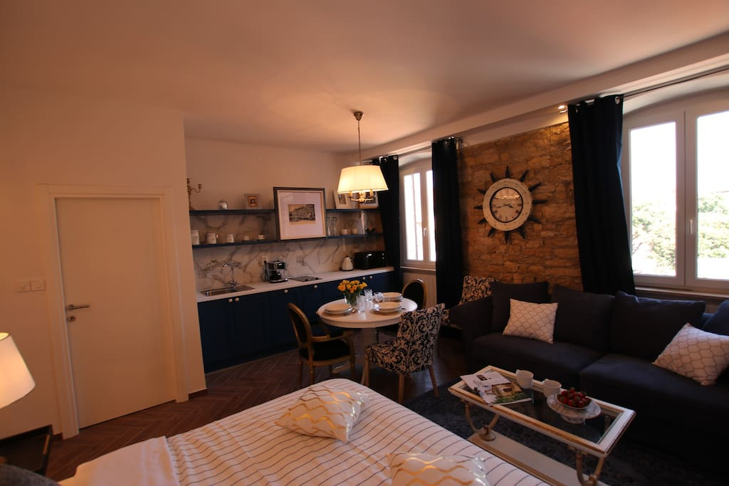 Studio apartment area is 30m2 with king size bed, sofa, fully equipped kitchen and shower bathroom.
