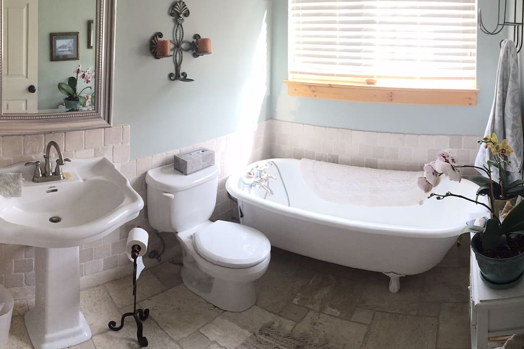 Bathroom has a antique bathtub for a relaxing soak after a long road trip or a hard day of hiking