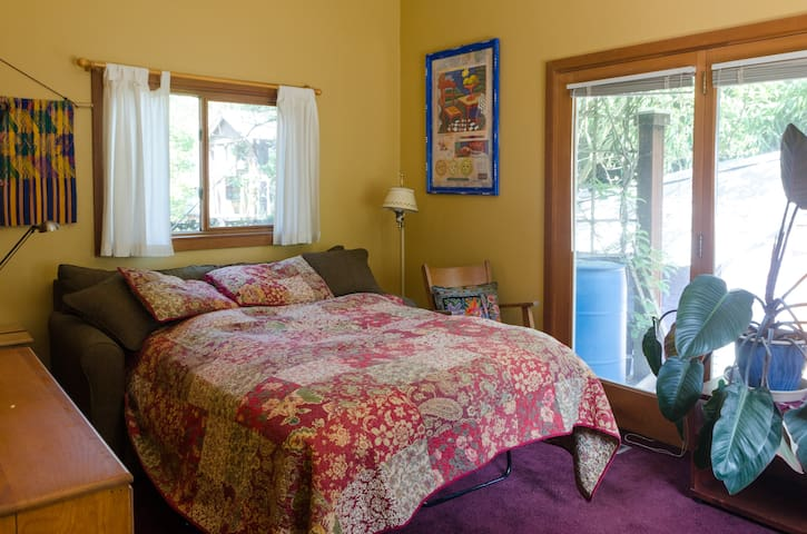 Your bedroom. Sunny, with a private view of the back yard.