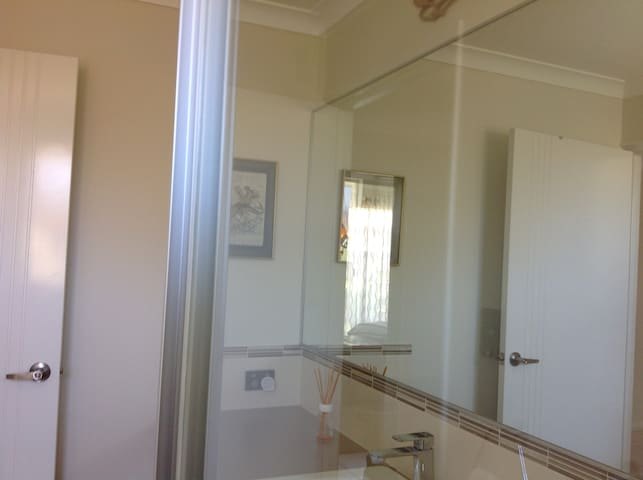 Modern bathroom with loads of cupboard space