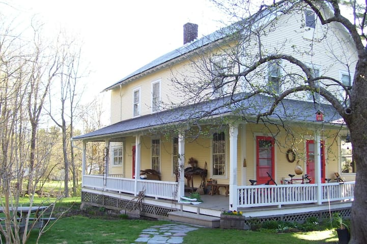 Two private bedrooms, porch, brook, in town