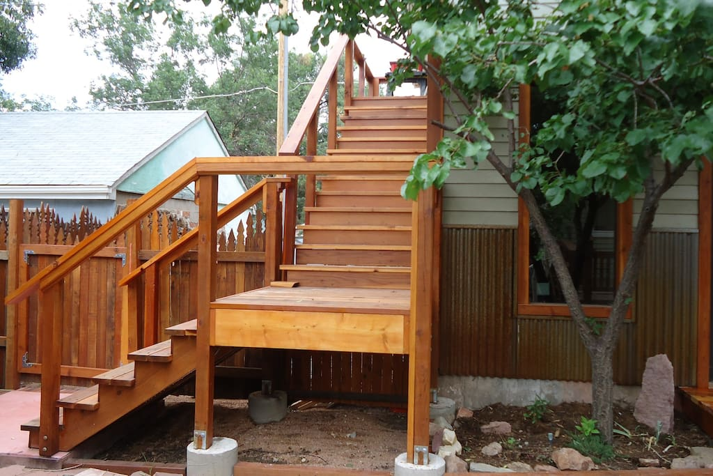 Stairs up to the studio & the gate from the parking area