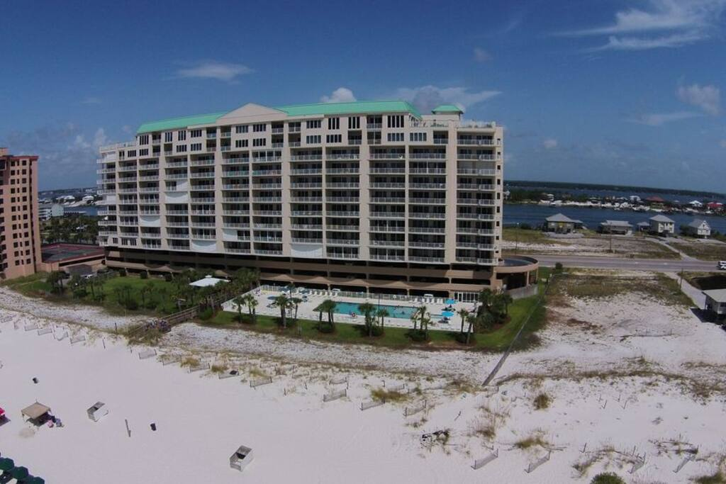 The building is wider than it is tall. Wide building = Wide beach! Lots of room!