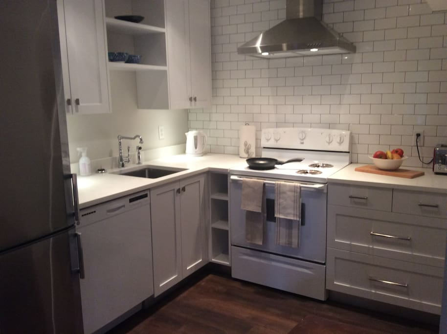 Quartz countertops, stainless steel sink, hood and fridge, quality cabinets.