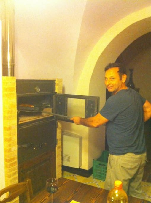 The kitchen boasts an actual wood burning pizza oven built by the owner himself.