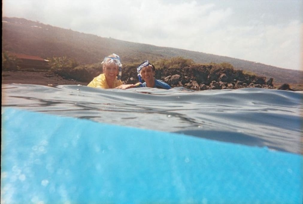 Two of my guests enjoying the snorkeling in our own bay (about 2 mins from the studio)