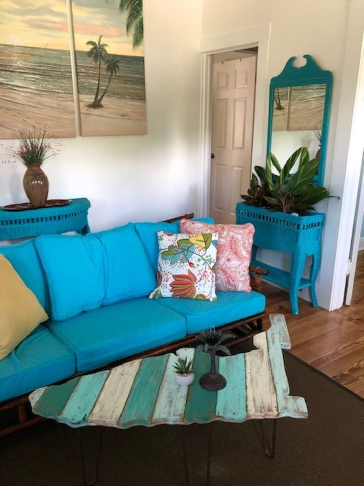 """Welcome to your wonderful """"Old Florida"""" oasis!  Living Room is full of light and authentic retro coastal furnishings sourced for the sophisticated and discerning eye.  Original local art abounds along with other personal touches to welcome you."""