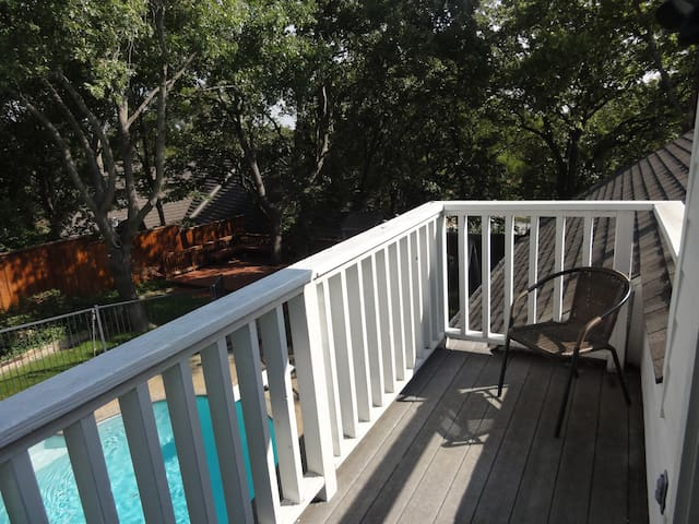 Get some fresh air on the cozy 2nd story balcony overlooking the backyard and pool.