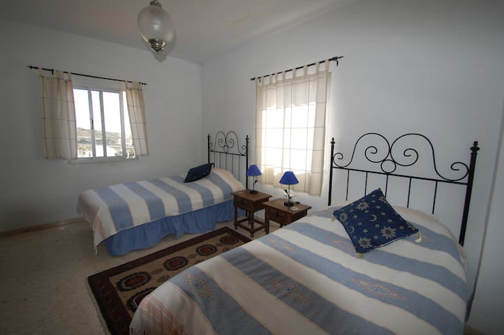 Twin bedded room with sea view