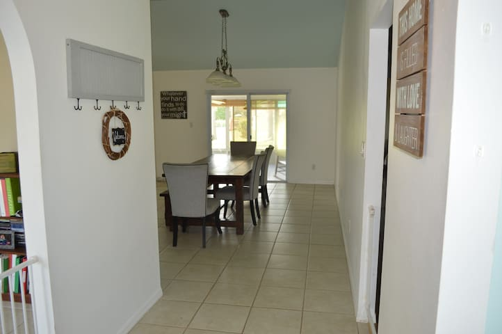 Walking into the front door... to the front is a large dining area. Table has four chairs and a bench. Seats 8