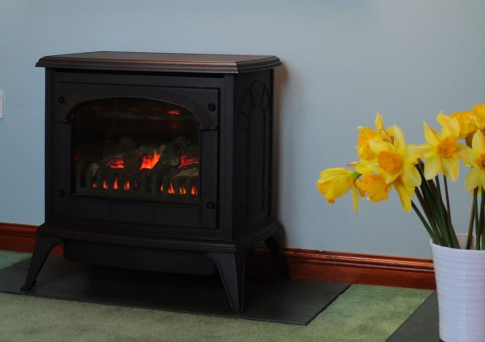 A featured cast iron stove gives a cosy warmth on a chilly day