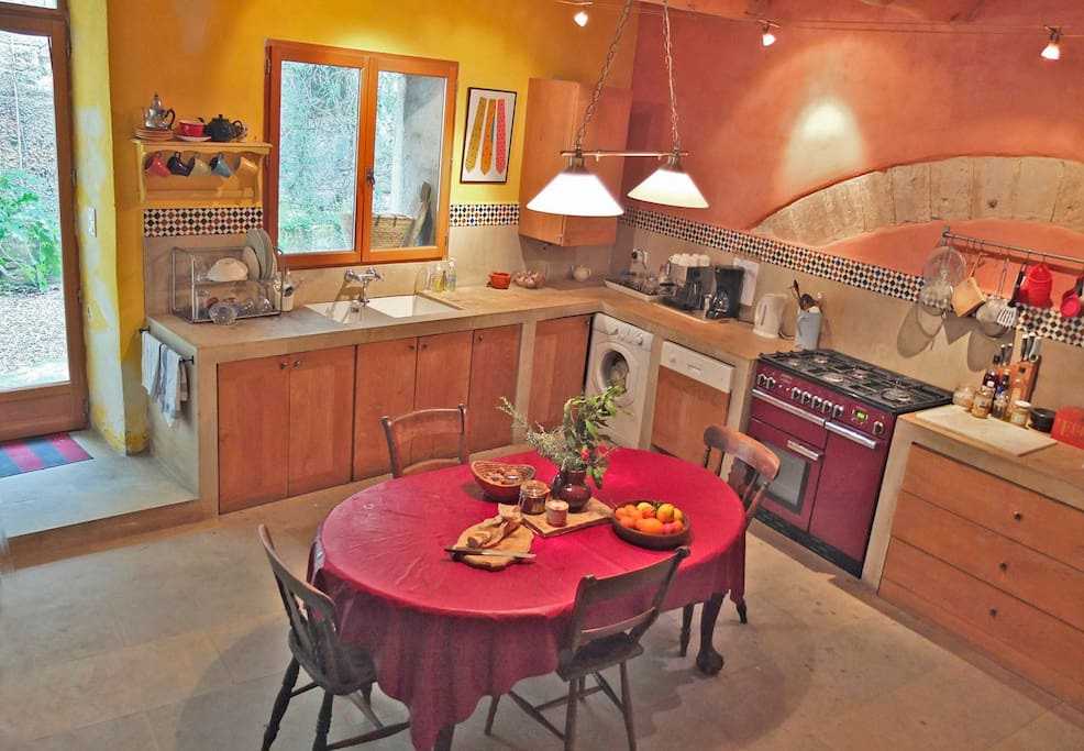 Fully equipped kitchen with cooking range and microwave