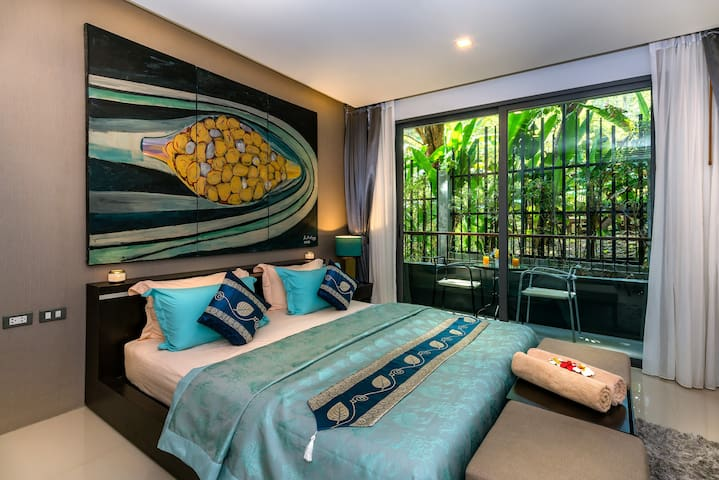 Comfortable bed with garden view