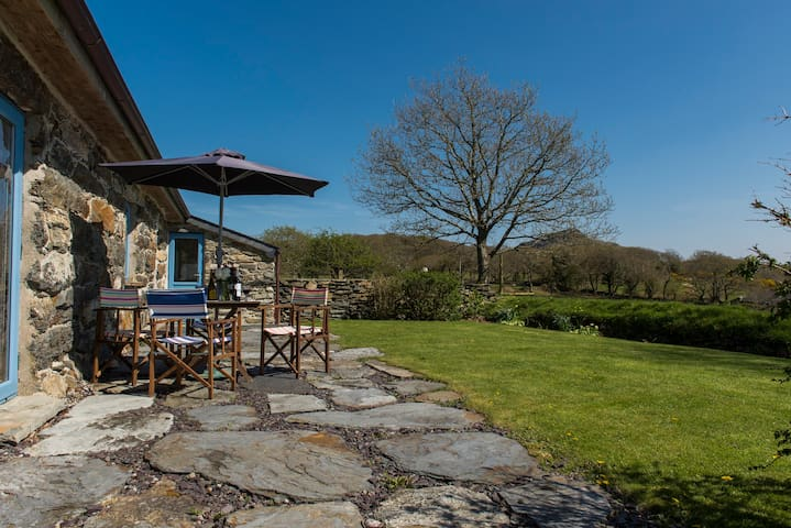 The delightful Patio has superb views right across the Llyn Peninsular