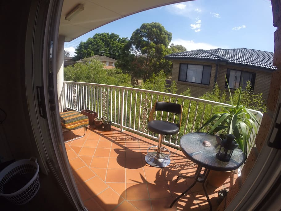 Sunny balcony, is now equipped with a wooden bench & 4 chairs.   Very enjoyable spot to chill with singing birds background.