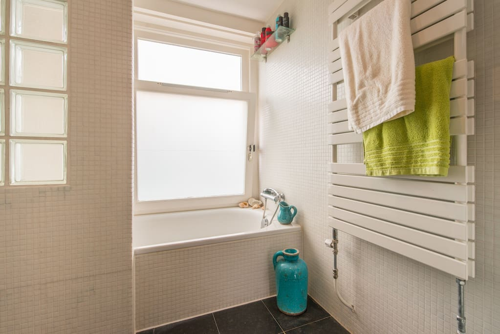 Bathroom containing; bath, seperate shower, toilet, washing machine and dryer