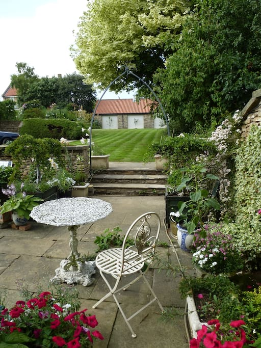 Find a nook in our walled garden an (apart from the birds) find some peace.