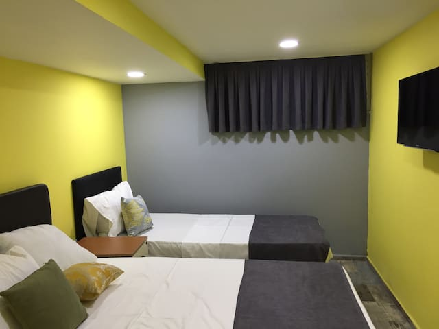 Double and single beds in the bedroom