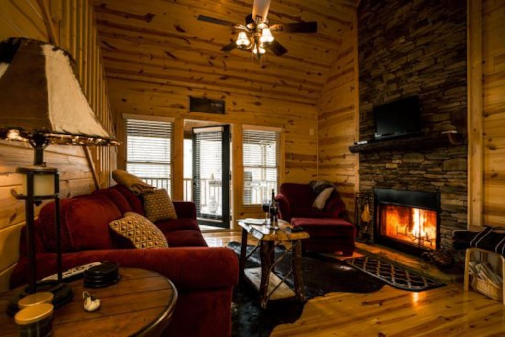 Luxurious living area with fireplace and DirectTV 250 programming!