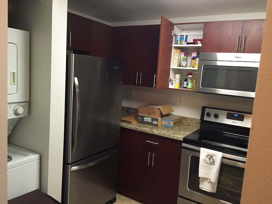 Washer and drier, New appliances including microwave, stove, dishwasher.