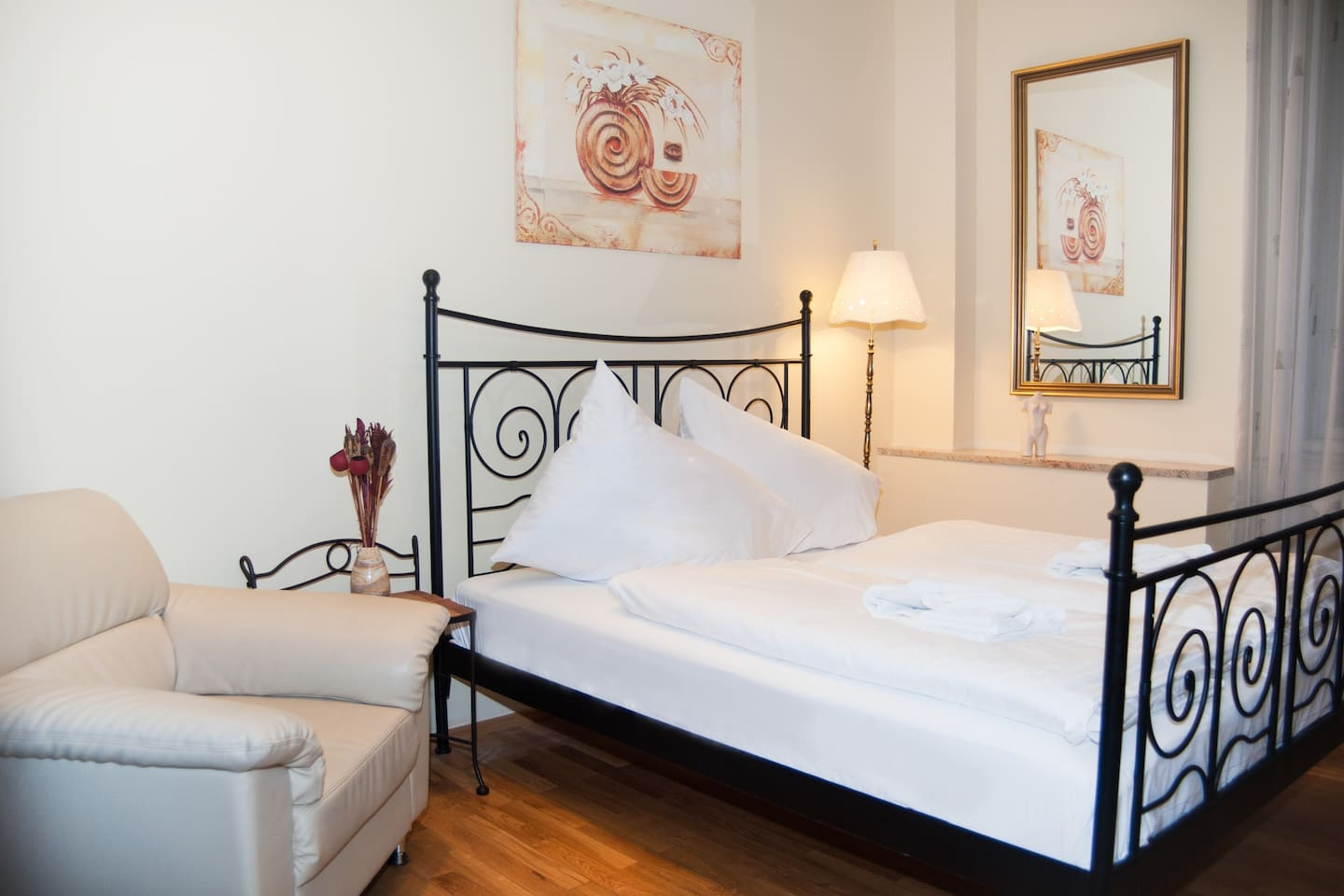 Bright bedroom with comfortable double bed