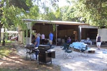 Four Bay concrete Carport with Barstools & Table. Grills available on request. Additional fees for parties or reunions.