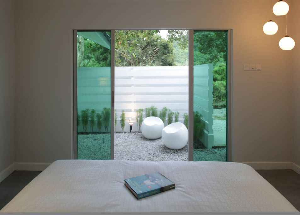 View from King-sized bedroom to courtyard.
