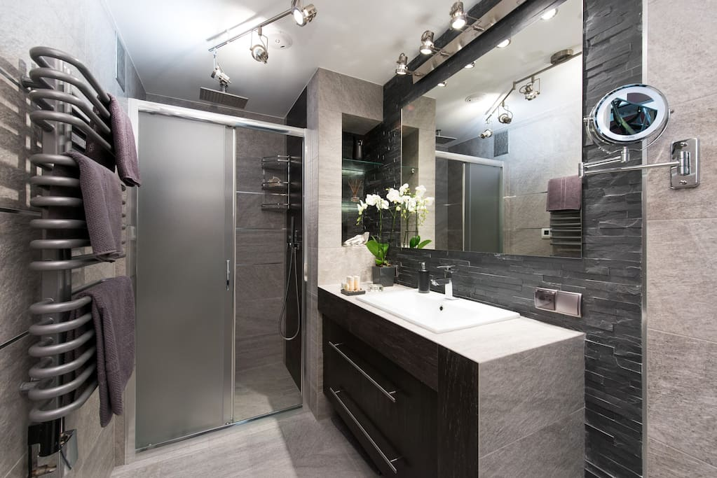 Luxury bathroom with a shower for two, audio system and heated floor