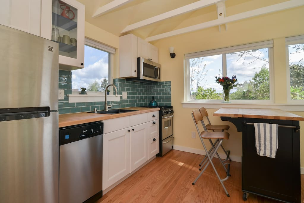 Full kitchen with dishwasher, microwave, gas range and oven.