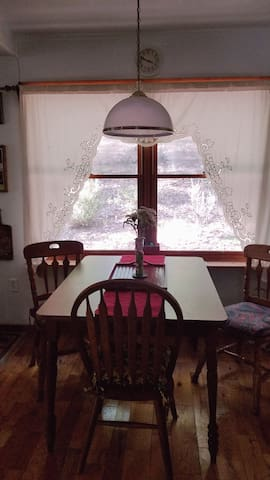 DINING AREA WITH VIEW OF THE BACK OF THE PROPERTY