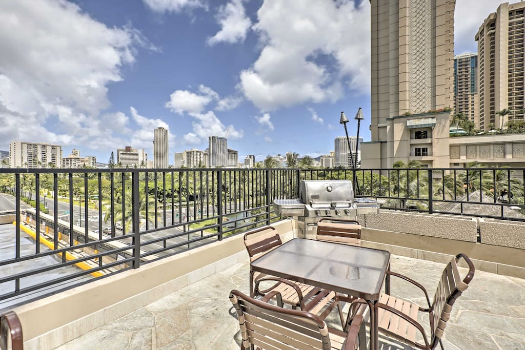 Enjoy city views from the balcony and community pool area.