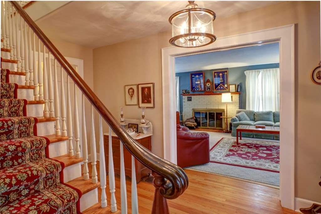 First floor entrance hallway, living Rooom and stairs leading to guest bedrooms