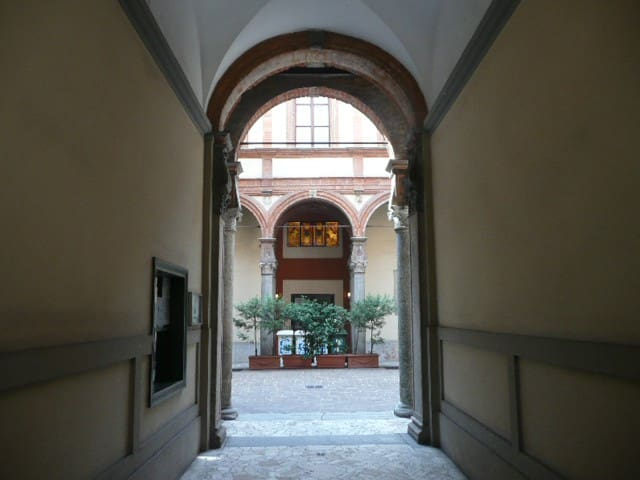 Main gate building entrance to Bramante's Renaissance courtyard with Green (glass) Brown (organic) and White (paper) differentiated garbage collection (Yellow (metal & plastic) and Gray (medical, condoms, tampax etc.) in staircase C basement