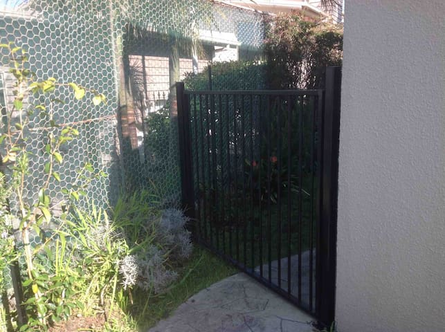 Access to the backyard. Side gate. Lockable for small children's safety,  and security for big boys toys left outside - bikes, surfboards etc.