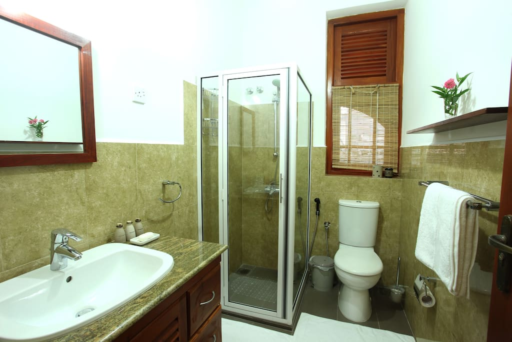 Adjoining Private Bathroom with modern amenities