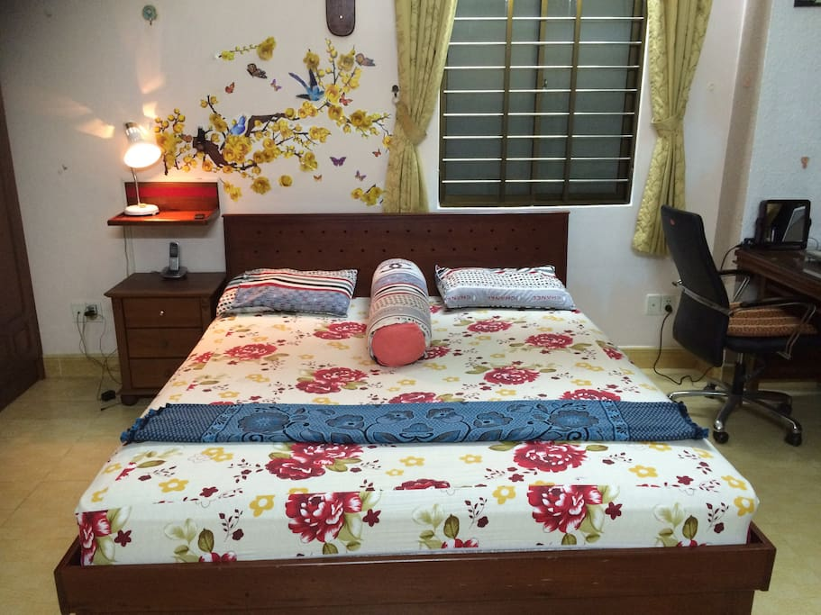 Wooden double bed and cabinet in front of bed