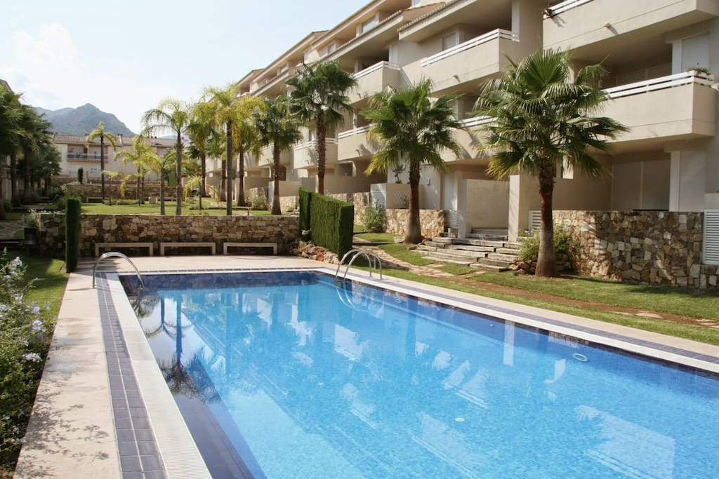 Well maintained garden with 2 large swimming pools