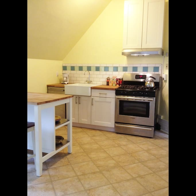 Newly remodeled large eat-in kitchen with Bosch appliances (including gas stove and dishwasher), coffee maker, tea kettle and selection of teas