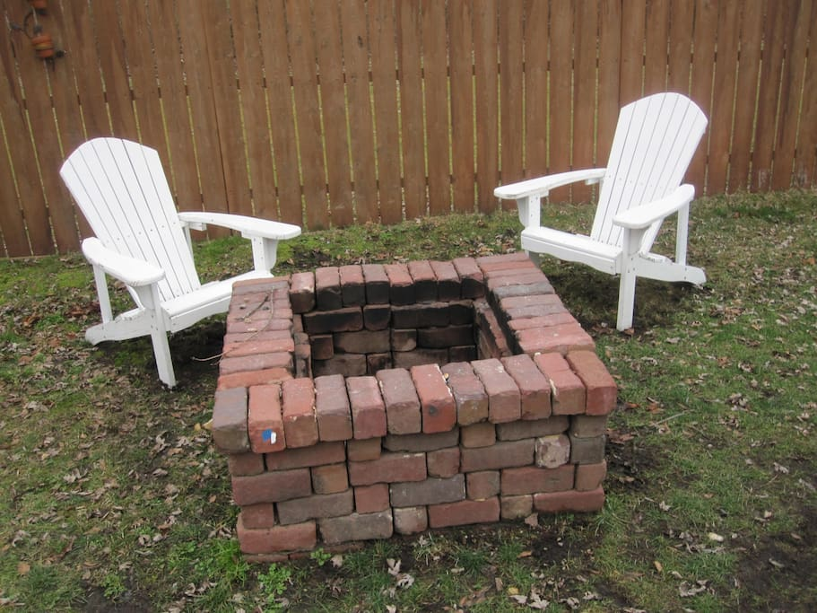 fire pit in fenced in back yard