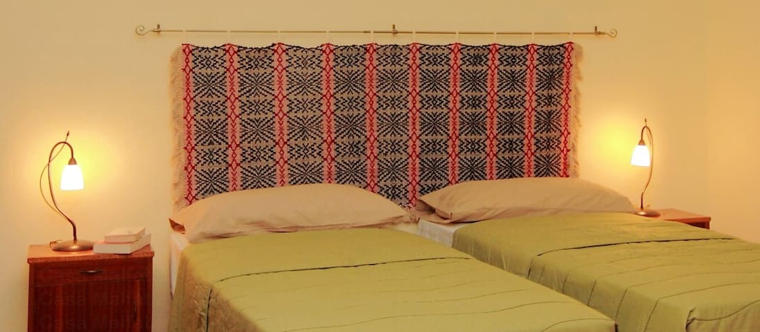 There is a traditional Sardinian wall carpet in the second bedroom
