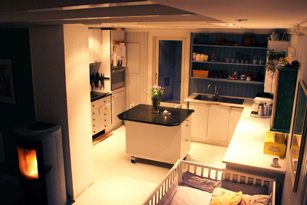 Kitchen and fireplace by night