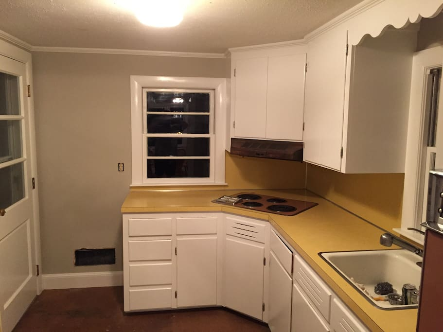 Freshly painted kitchen cabinets and walls with vintage GE 4 burner stove top